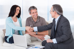 Consultant Shaking Hand With Happy Woman